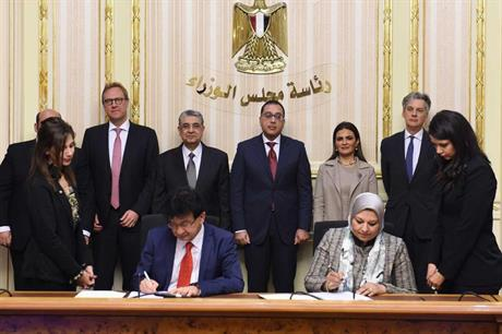 The power deal was signed in the presence of Moustafa Madbouly, Egypt's prime minister (centre), and representatives of Actis, Lekela and other cabinet ministers