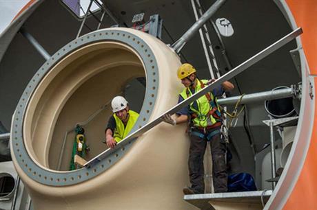 Workers installing Prokon's 3MW prototype turbine