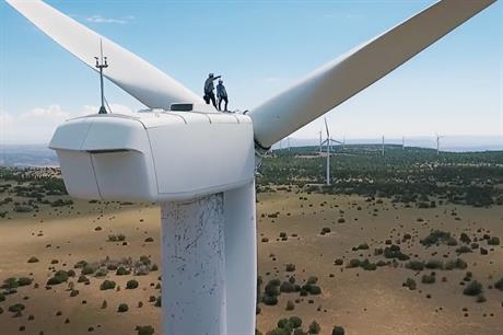 New Mexico governor-elect Michelle Lujan Grisham atop a turbine in a TV campaign