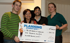 Quiz night: champions Kingston University's the Last Bastion of Communism hold their prize. Emmaruth Rimando photo