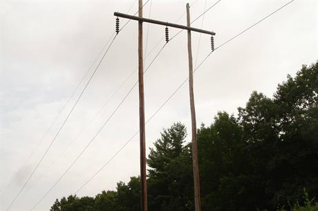 An example of a wooden trident-style power line from the USA. Pic: Jimhann8254, Wikipedia.