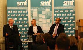 (from left) Heseltine, BBC presenter Evan Davis and Umunna at the SMF debate