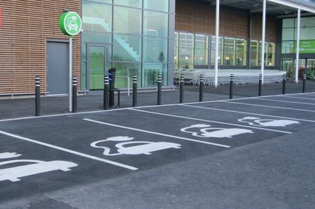 Electric car parking spaces at a supermarket in Inverness [Pic credit Glen Wallace via Flickr]