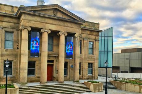 The town hall's classical portico is retained, while an extension provides a new foyer (PIC Oldham Council)