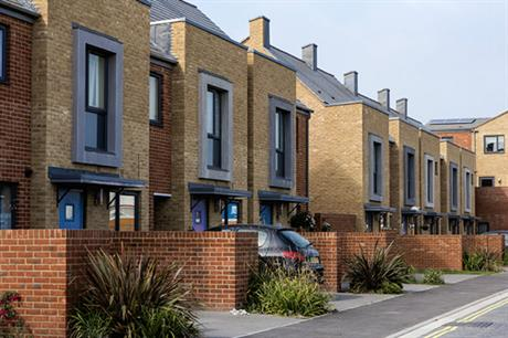 The terraces' durable brickwork and planted front gardens (PIC Architecture  ...