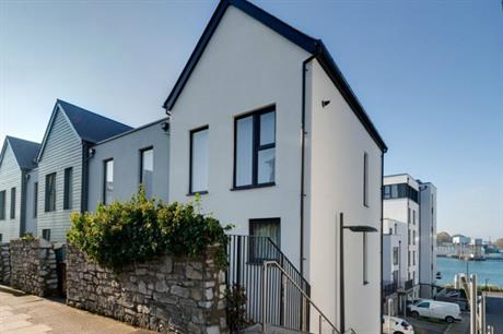 A limestone and granite wall forms the rear boundary to the housing (PIC HTA)