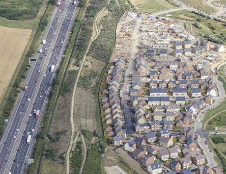 A green ridge in Milton Keynes was acts as a noise barrier for the Brooklands housing scheme [Pic credit: Places for People]