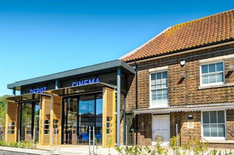 The cinema screens occupy the refurbished warehouse, while the new glazed section provides other services (PIC Burrell Foley Fischer)