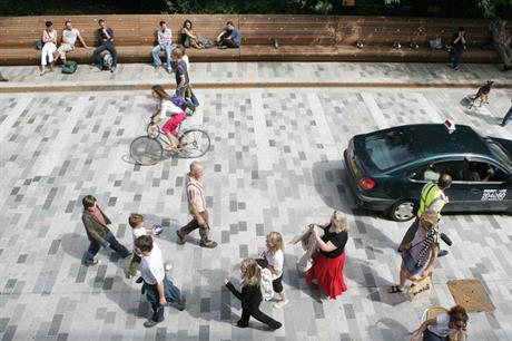 The shared space in New Street, Brighton, is used by pedestrians, cafes and a few cars (PIC Gehl Architects)