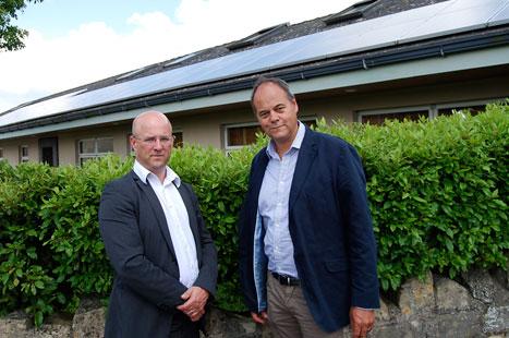 Dr Eavis (l) and solar panel installer Steve Barrett