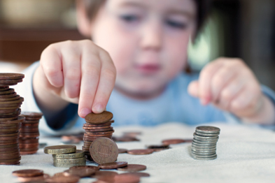 Junior ISAs should be available from 1 November and allow both parents and grandparents to contribute to a child's account (Photograph: Istock)