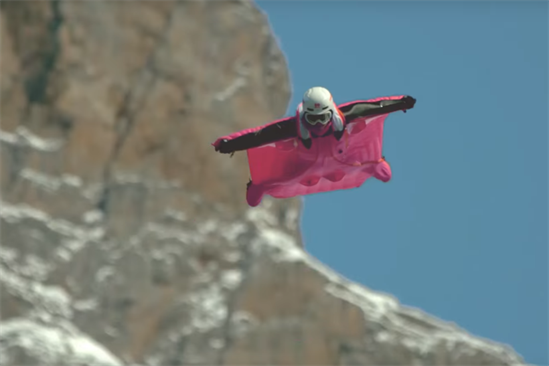 "Dunkin' Donuts ""#WTFast"" campaign takes flight in a fuchsia wingsuit"