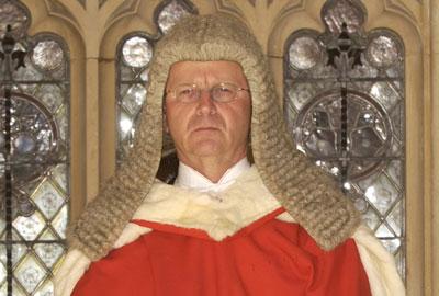 Honourable Mr Justice Warren