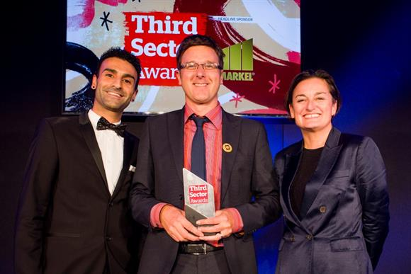 Stephen Hale collects his award from host Zoe Lyons (right) and Eddy Lee from Third Sector Jobs