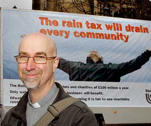 Reverend Andy Salmon with a campaign poster