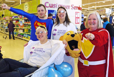 Staff from the Tesco Extra in Dundee raised £22,000 for CRUK