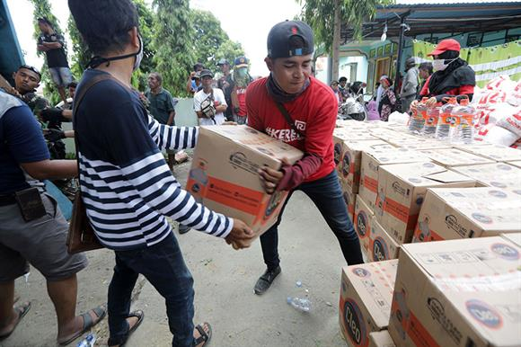 Aid work after the Indonesian tsunami (Photograph: Hotli Simanjuntak/EPA-EFE/Shutterstock)