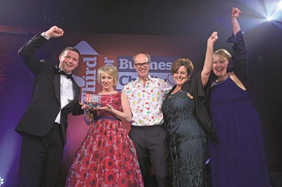 Host Will Gompertz (centre) with winners of the Business of the Year, Greggs