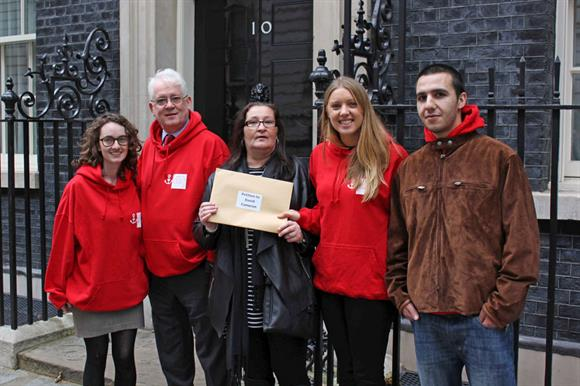 Protestors deliver the petition to Number 10