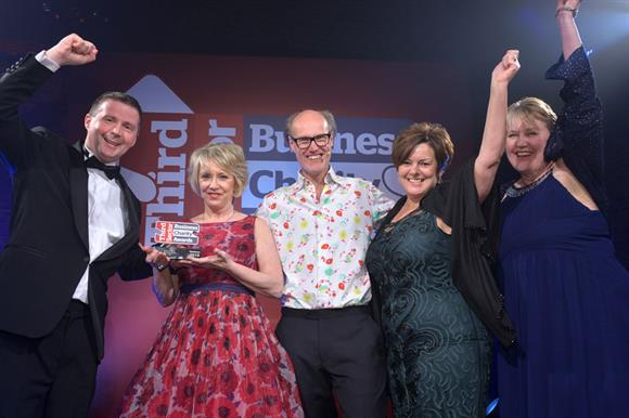 Jan Barratt of Experian, second from left, hands the award to Greggs representatives as host Will Gompertz, centre, looks on