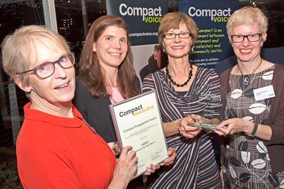 HMRC representatives with award