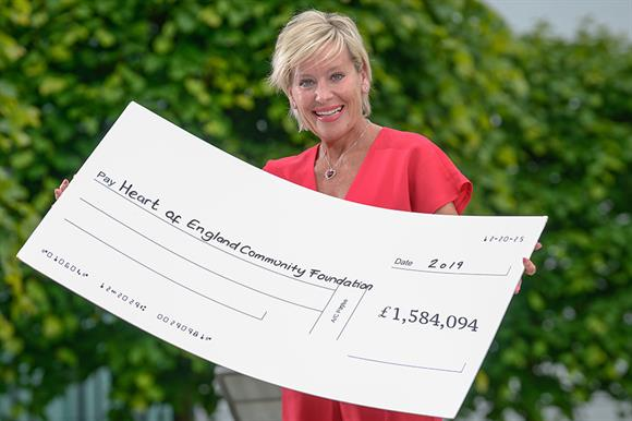 Tina Costello with the donation cheque