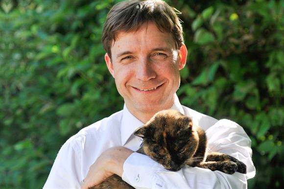 James Yeates with his cat, Monkey
