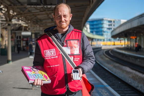 Big Issue vendor Mike Hall with his contactless card machine