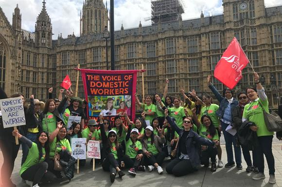 Supporters of The Voice of Domestic Workers campaigning outside parliament