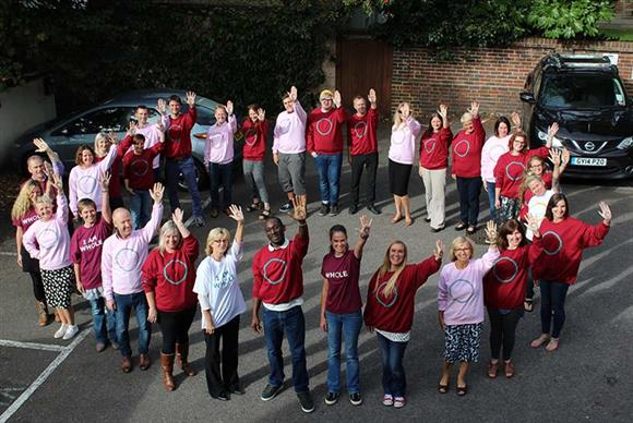 YMCA DownsLink Group employees showing their support for the 'I am whole' campaign which promoted support for mental health