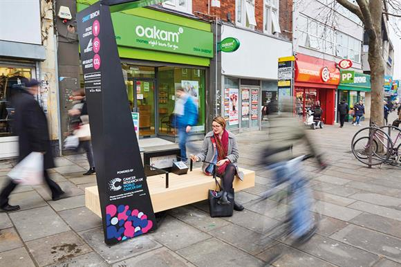 Cancer Research UK's contactless donation bench in use