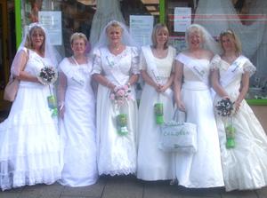 Brides: staff don gowns