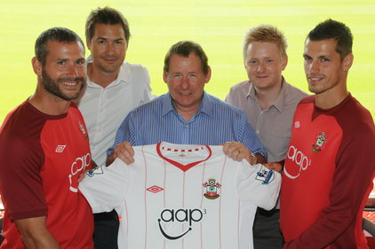 Aap³ CEO Rod Jackson, centre, with Southampton FC players and some of the Remarkable Group team