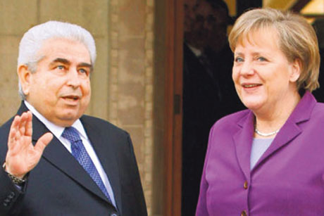 Differences: Dimitris Christofias and Angela Merkel (Credit: Getty)