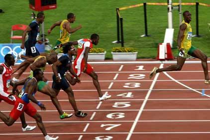 Ahead of the pack: Usain Bolt wins Beijing gold (Rex)