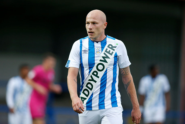 Australian international Aaron Mooy sports a fake Huddersfield kit in a friendly with Rochdale. (Photos by John Early/Getty Images)