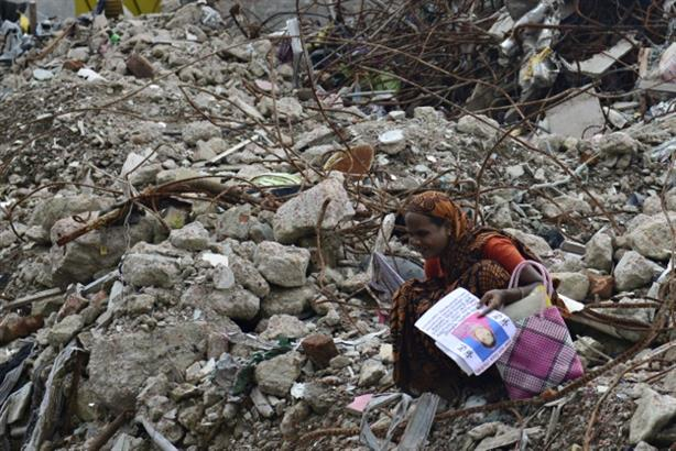 Global fashion labels found their reputation buried along with the factory workers who used to make their garments at Rana Plaza. Here a woman grieves at the loss of a loved one who died in the 2013 factory collapse. (Pic: AFP)