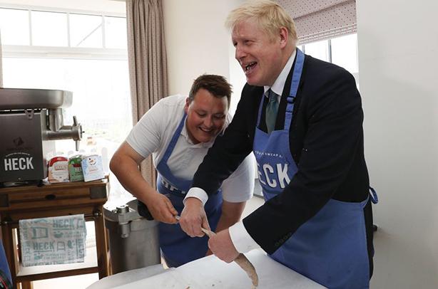 Boris Johnson enjoys a spot of sausage making on the campaign trail