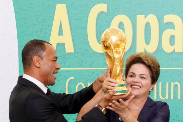 Brazil President Dilma Rousseff holds the World Cup trophy at the start of the tournament.