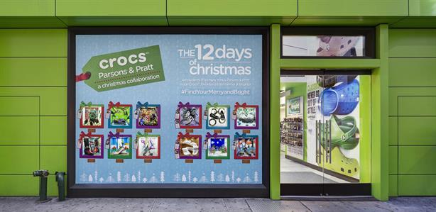 be121b410 Crocs steps into holiday season with student-created window art