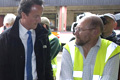 Back for good: Cameron cut short his Rwandan trip to  visit  areas affected by flooding