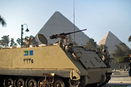 Turmoil: Tanks have become a regular sight in Egypt [Pic: Getty]