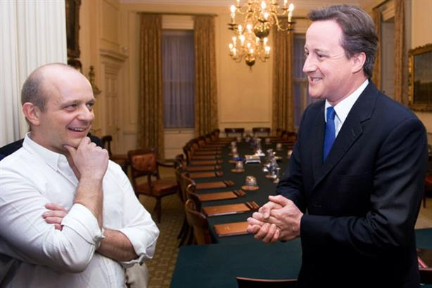 Victorious: Hilton with Cameron on the night he became PM (Rex Features)