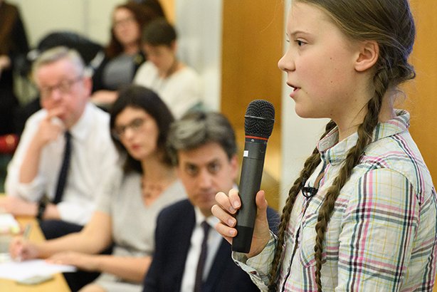 Greta Thunberg addresses the Parliamentary Climate Change Group meeting last week, including Michael Gove and Ed Miliband (pic credit: Leon Neal/Getty Images)
