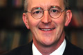 Benn: wants inefficient bulbs phased out by 2011