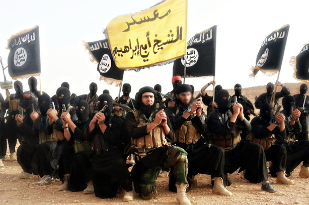 Isis fighters pose in a propaganda photo released by the organisation (pic credit: Handout / Alamy Stock Photo)