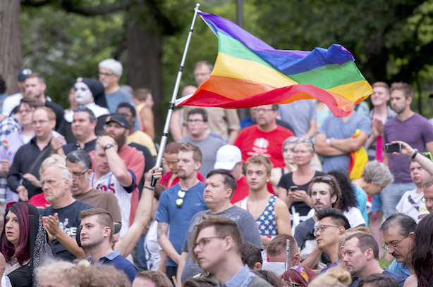 The scene at a vigil in Minneapolis after Sunday morning's mass shooting in Orlando, Florida. (Image CC BY 2.0, By https://www.flickr.com/photos/fibonacciblue).