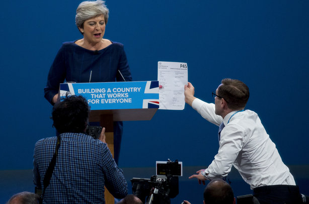 Theresa May is handed her P45 (pic credit: DAVID HARTLEY/REX/Shutterstock)