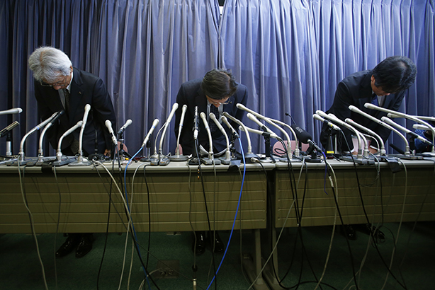 Sorry: Mitsubishi bosses at yesterday's announcement (Credit: AP Photo/Shizuo Kambayashi)