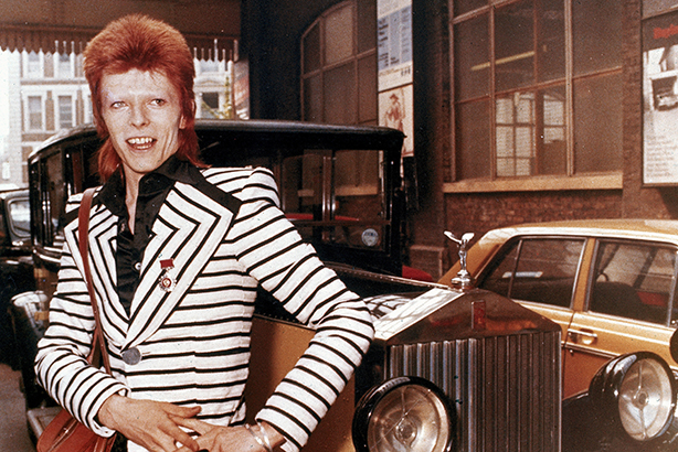 David Bowie poses beside his Rolls Royce in May 1973 (credit: AP/EMPICS/PA)